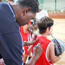 Sam Mitchell signing camper autograph